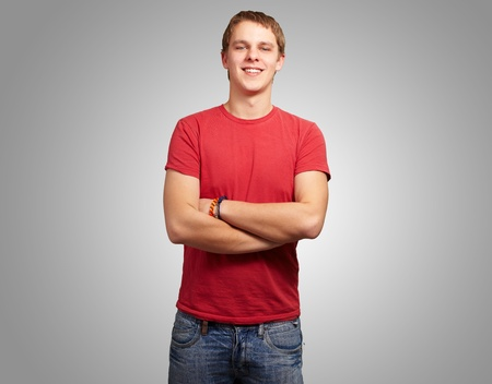 portrait of young man smiling over grey background photo
