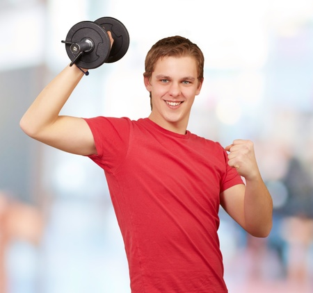 young man doing fitness with weights indoor photo
