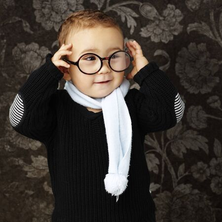 kid wearing round glasses against a vintage background photo