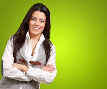 portrait of a happy girl smiling against a green background Stock Photo - 13280362