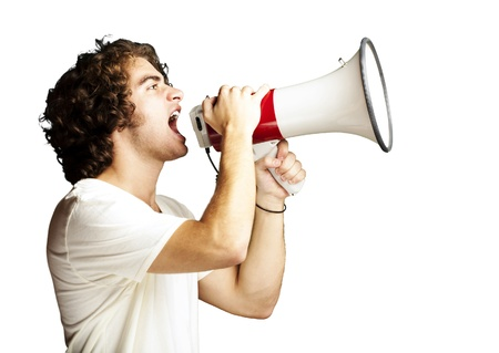portrait of a handsome young man shouting with megaphone against a white background