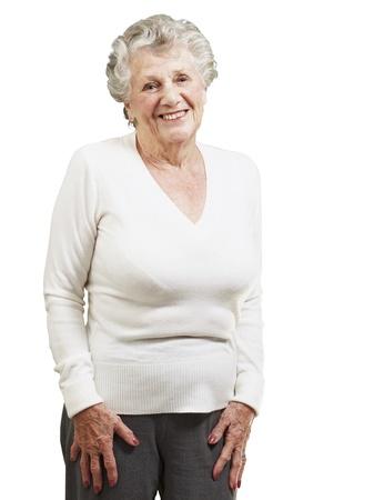 pretty senior woman smiling against a white background