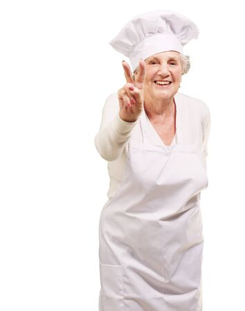 portrait of cook senior woman doing approval gesture over white background Stock Photo - 13607370