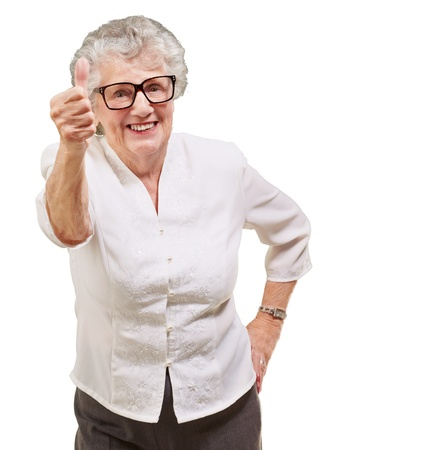 portrait of adorable senior woman doing good gesture over white