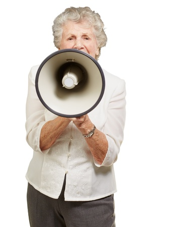 portrait of senior woman screaming with megaphone over white background photo