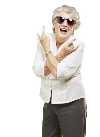 roll up: portrait of senior woman doing rock symbol over white background