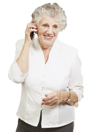 ancient telephone: portrait of senior woman talking on mobile over white background Stock Photo