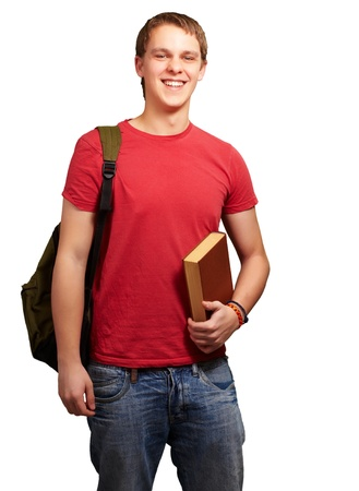boy book: portrait of young student holding book and carrying backpack over white Stock Photo