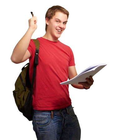 portrait of handsome student holding notebook and pen over white photo
