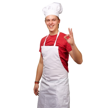 portrait of young cook man doing success symbol against a white background Stock Photo - 13607111