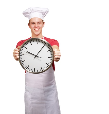 portrait of young cook man holding clock over white background Stock Photo - 13607033