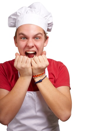 portrait of young cook man screaming over white background photo