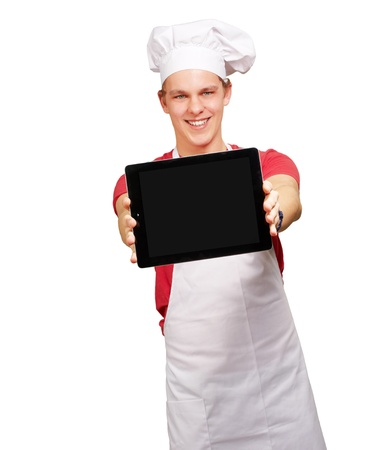 portrait of young cook man showing a digital tablet over white background photo