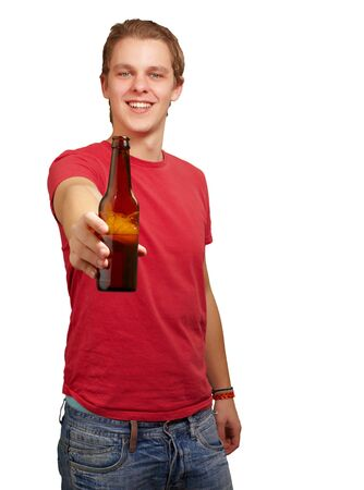 portrait of young man holding beer against a white background Stock Photo - 13607337