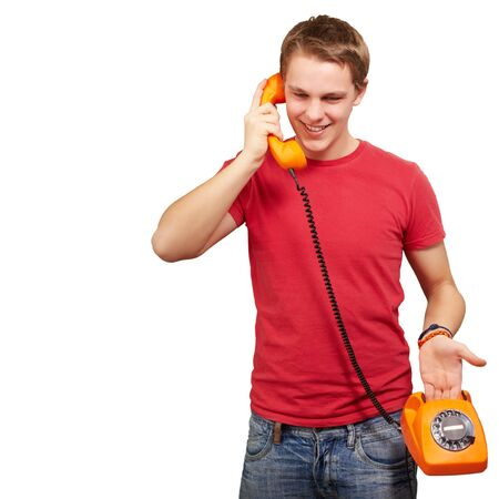 old cell phone: portrait of young man talking on vintage telephone over white background Stock Photo