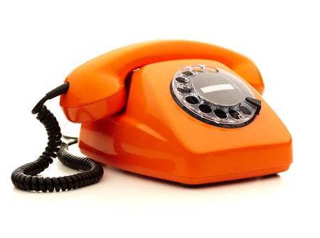 speaker phone: Vintage orange telephone over white background