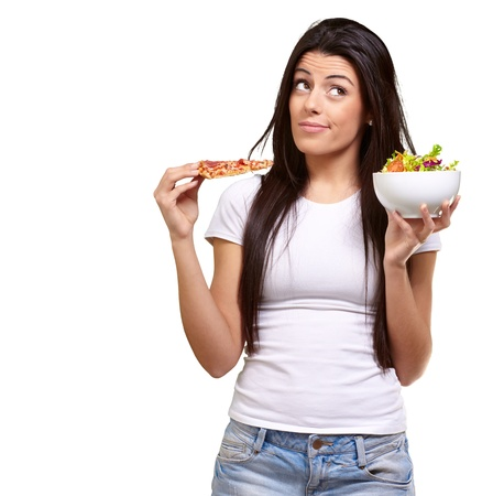 portrait of young woman choosing pizza or salad against a white background Stock Photo - 13609643