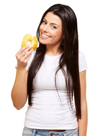 portrait of young woman eating a donut over white Stock Photo - 13609437