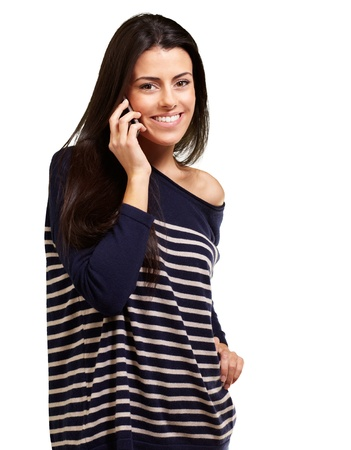 Young woman talking on mobile over white background photo