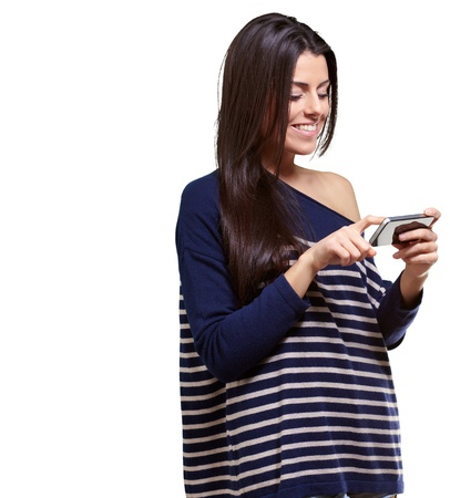 smart girl: portrait of young woman touching a modern mobile over white