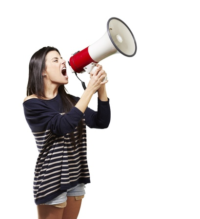 young woman shouting with a megaphone against a white background photo