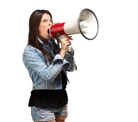 portrait of young woman screaming with megaphone against a white background photo