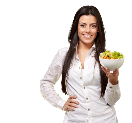 portrait of young woman holding salad over white Stock Photo - 13609559