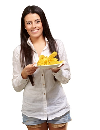 portrait of young woman holding a potato chips plate over white background