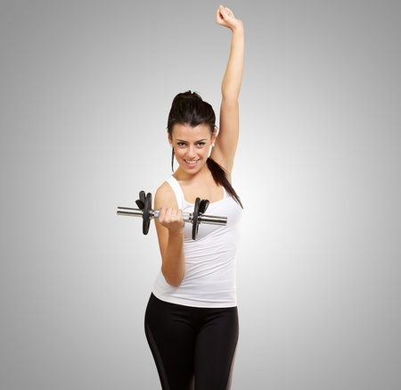 portrait of young woman doing fitness with weights photo