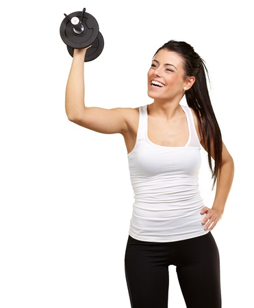 portrait of young girl training with weights over white background photo
