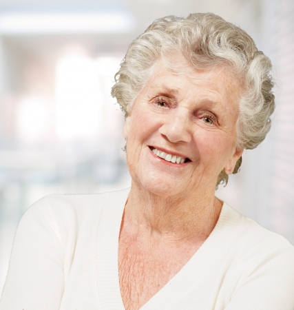 portrait of senior woman smiling against a abstract background