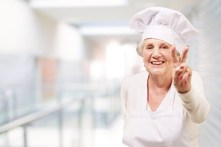 portrait of cook senior woman doing good gesture at restaurant Stock Photo - 14252077