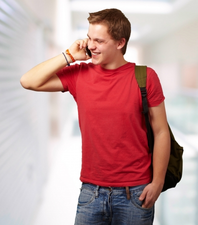 portrait of young man talking on mobile at modern building photo