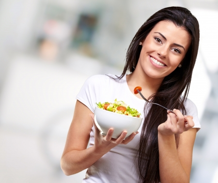 woman healthy: portrait of healthy woman eating salad indoor