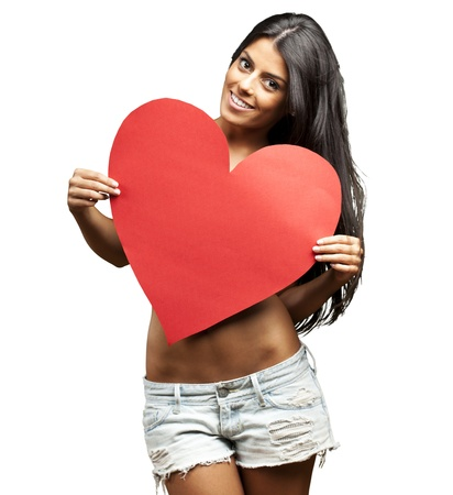 portrait of young woman holding red heart against a white background