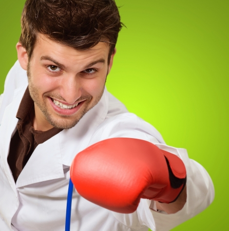 handglove: Doctor In Red Boxing Hand Glove On Green Backround Indoor Stock Photo