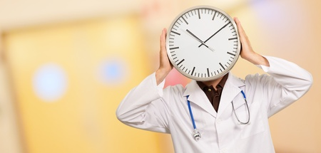 Doctor Holding Wall Clock Stock Photo - 14438943