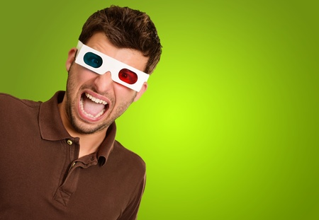 stereoscopic: Astonished Man Wearing 3d Glasses Isolated On Green Background Stock Photo