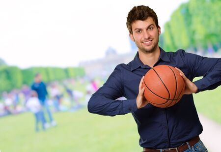 Portrait Of Young Man Holding Basketball, Outdoor photo