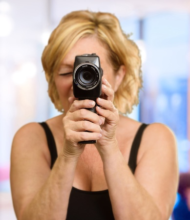 Woman Holding A Videocamera, Outdoor photo