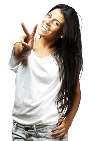 Gelukkig jonge vrouw zien Victory teken op witte achtergrond Stockfoto - 14704127