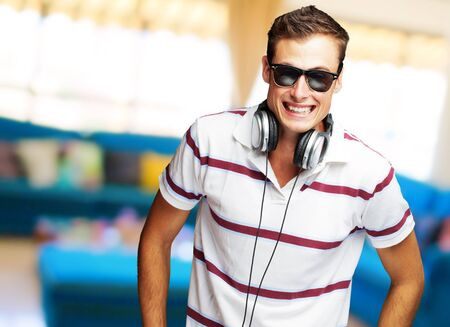 Portrait Of A Handsome Young Man Listening To Music, Indoor photo