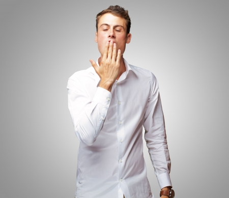 Portrait Of Young Man Yawning Isolated On Gray Background Stock Photo - 14706811