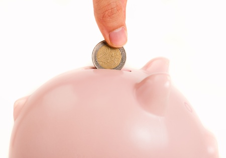 pennypinching: Portrait Of Piggy Bank On White Background Stock Photo