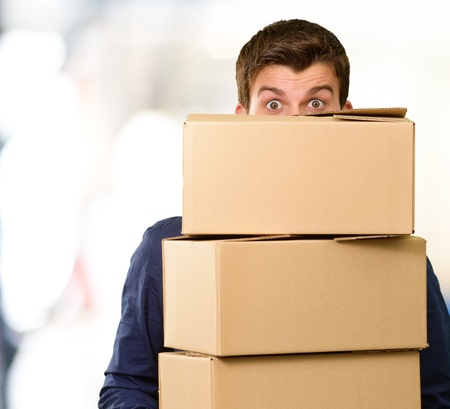 Man holding cardboard boxes, outdoor Stock Photo