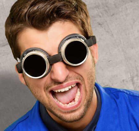 Portrait of an engineer wearing goggle, indoor Stock Photo - 14706985