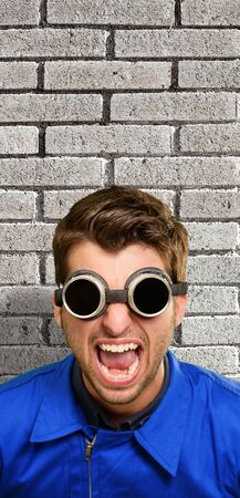 Portrait of an engineer wearing goggle, indoor Stock Photo - 14683273