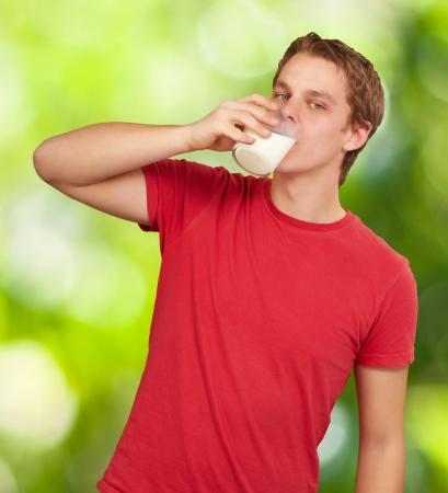 portrait of young man drinking milk against a nature background Stock Photo - 14706807