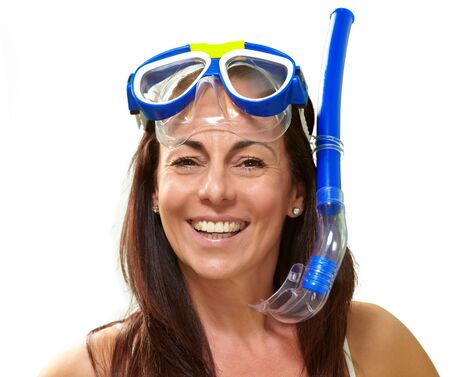portrait of a happy middle aged woman wearing snorkel and goggles over white Stock Photo - 14704062