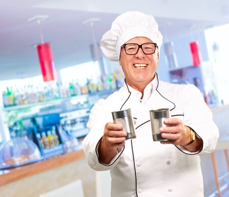 Portrait Of A Chef Holding Drink, Indoor photo